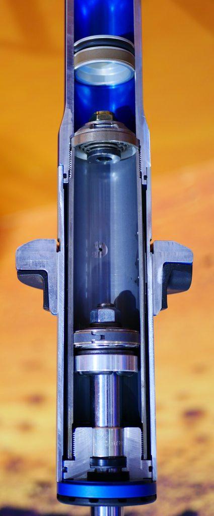 Motorcycle shock cutaway demonstrating the use of fluid.